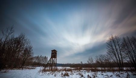 Winter landscape photographed with long exposure. Natural wild landscape with raised hide.