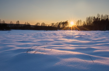 Winter landscape at beautiful sunny evening. Tranquil winter scene.