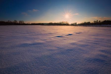 Winter landscape at beautiful sunny evening. Tranquil winter scene.