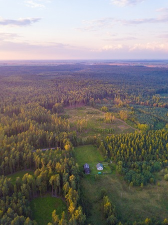 Aerial: FIelds in sunset light. Drone view Stock Photo