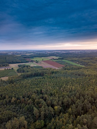 Beautiful sunset  with strange clouds over forest. Drone landscape.