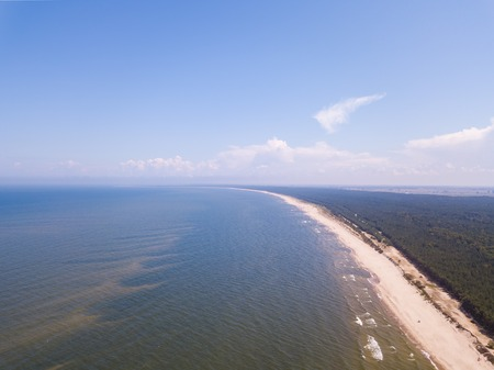 Baltic beach from above. Drone photography with sandy shore and waves of sea. Stock Photo