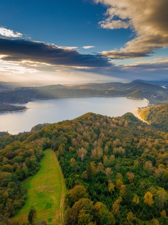 Solina lake in Bieszczady mountains in Poland at beautiful cloudy sunset. Aerial view on mountain lake. Archivio Fotografico