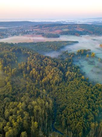 Beautiful foggy morning landscape photographed from above. Aerial landscape photographed in Poland. Stock Photo
