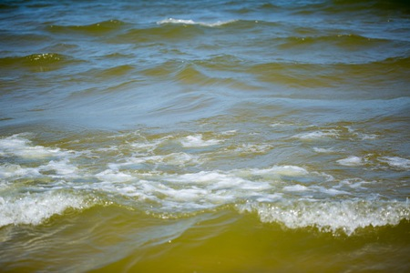 Sea Waves breaking on shore. Baltic Sea waves in close up.