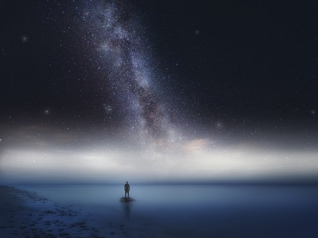 Surreal sea at night landscape with starry sky. Dreamy look.