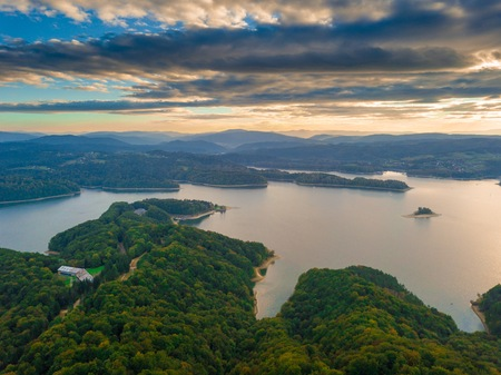 Solina lake in Bieszczady mountains in Poland at beautiful cloudy sunset. Aerial view on mountain lake. Stock Photo