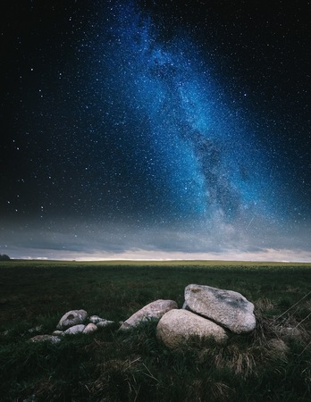 Surreal night landscape with starry sky. Dreamy look. Stock Photo