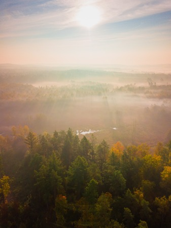Aerial landscape with foggy sunrise over meadows and forest. Polish landscape. Stock Photo
