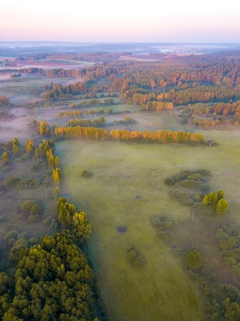 Beautiful foggy morning landscape photographed from above. Aerial landscape photographed in Poland. Zdjęcie Seryjne