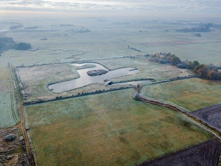 Drone ladnscape with pond and river in polish fields. Polish drone landscape