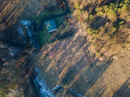 Early spring top down drone landscape. European fields and forests.