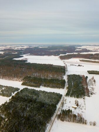 Winter aerial landscape photographed from drone. European winter with snow. Zdjęcie Seryjne