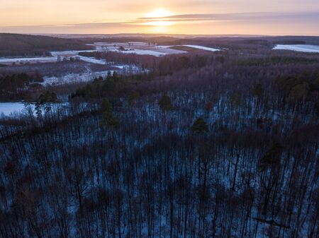 Aerial landscape with winter in european forest and field. Polish winter.