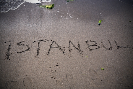 istanbul beach: Writing Istanbul At The Sands Stock Photo
