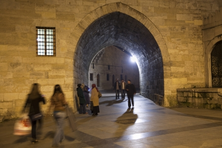 Istanbul, Eminonu, Turkey - March 30, 2013: Passageway near the New Mosque. Some peoeple passing under the passage at Eminonu district.