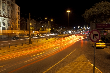 Istanbul, Karakoy, Turkey - May 29, 2012  Cars lights are visible at the long exposure image and some historical buildings at Istanbul,Karak�y District,Turkey  Also two cars some of theme is a taxi waiting right side of the street