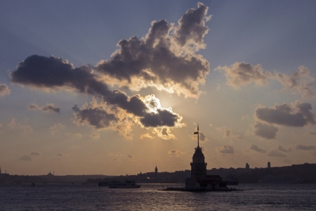 Silhouette of the Maiden s Tower in Istanbul, Turkey at the sunset  Which is standing in the middle of the Istanbul Bosphorus  photo