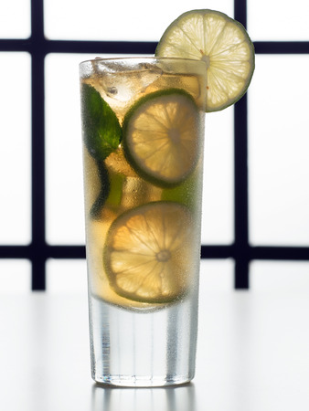 Fresh lemonade from lime with ice close up  photo