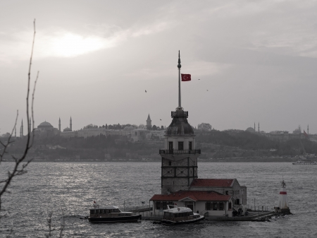 Istanbul, Turkey - January 21, 2014  The Maiden s Tower and Historic Peninsula are visible in Istanbul at sunset  Black and White with some colors
