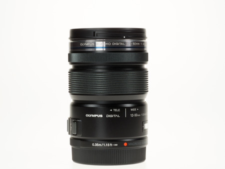 tele up: Istanbul, Turkey - January 29, 2014  Olympus M Zuiko Digital 12-50mm lens isolated on white background
