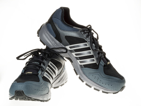 Istanbul, Turkey - January 29, 2014  New Adidas outdoor running shoes  Taken at studio and isolated on white