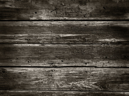 Old Wood Background from a wood houses wall - Sepia photo