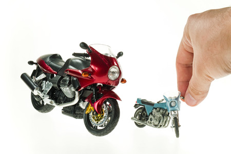 Realistic Toy Motorcycles with A Hand photo