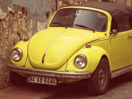 vw: Convertible Yellow VW Beetle - Vintage Tones