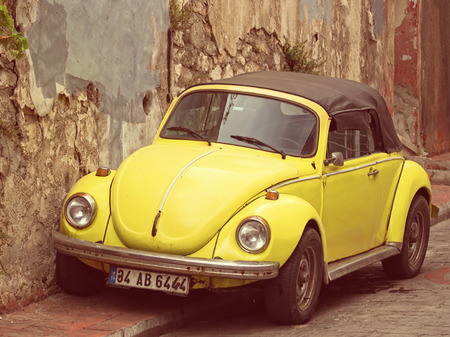 vw: Convertible Yellow VW Beetle - Vintage Tones