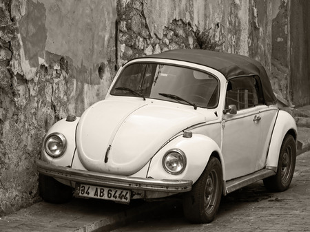 vw: Convertible Yellow VW Beetle - Sepia Tones Editorial