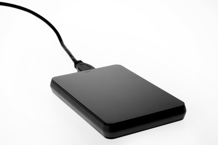 terabyte: An external hard drive with attached cable on a white background.