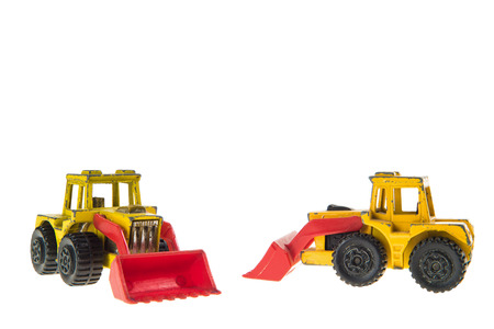 machinery space: Toy Bulldozers Isolated on White Background