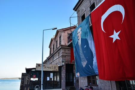 ataturk: Balikesir, Ayvalik, Turkey - August 29, 2015: Turkish Flag and Ataturk poster on a building  at Balikesir, Ayvalik, Turkey Editorial