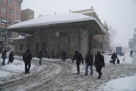 strongest: Istanbul, Eminonu, Turkey - January 9, 2017: Istanbul was covered with snow. This blizzard was the strongest of the last 30 years. There were people at the streets of The Eminonu with a fountain. Editorial