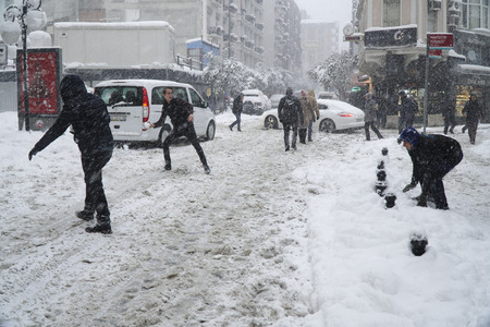 strongest: Istanbul, Eminonu, Turkey - January 9, 2017: Istanbul was covered with snow. This blizzard was the strongest of the last 30 years. There were people playing snowball at the streets of The Eminonu.