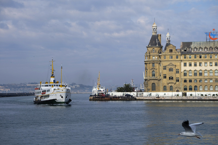 haydarpasa: Istanbul, Turkey - February 19, 2017: Traditional public transportation ships and The Istanbul View with The Haydarpasa Train Station Building. Editorial