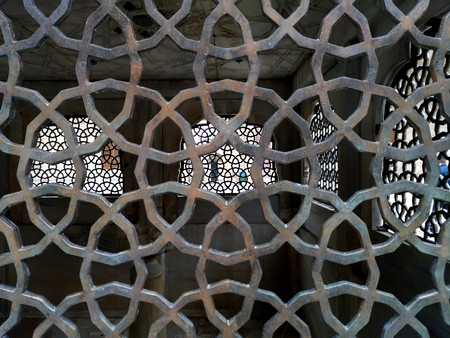 Antique handmade ironwork belongs to a famous mausoleum inside courtyard of The Suleymaniye Mosque at Istanbul.