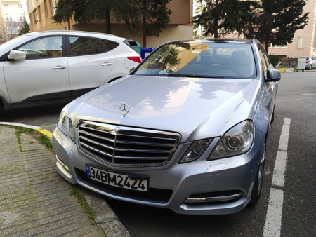Istanbul, Turkey - February 18, 2018: A parked Mercedes-Benz E250 at street of Istanbul with a suv.