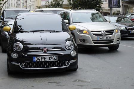 Istanbul, Turkey - February 24, 2018 : A new Fiat 500 with Vw Tiguan were parked at The Nisantasi Tesvikiye Street at Istanbul.  A Bmw is visible at the background. Editorial