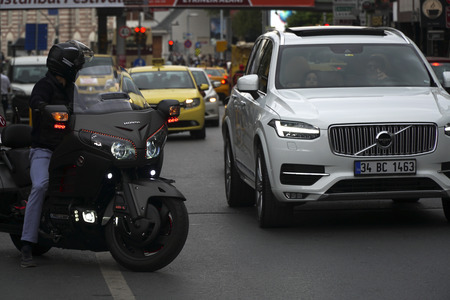 Istanbul, Turkey - October 7, 2017 : A Volvo XC90 giving way to the Honda Gold Wing at the main steet of Besiktas District, Istanbul.