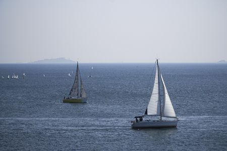 Sailboats are racing on the sea with Prince Islans at Istanbul