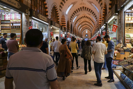 Istanbul, Turkey - May 17, 2018: The Famous Spice Bazaar in Istanbul with shopping tourists and shopkeepers.