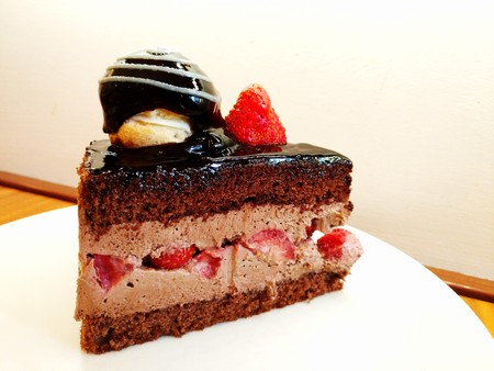 Slice of chocolate and strawberry cake in a dish