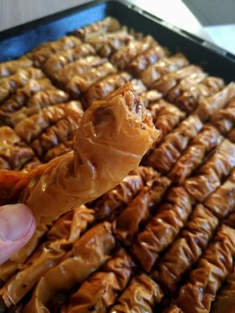 Home made walnut baklava on hand Zdjęcie Seryjne