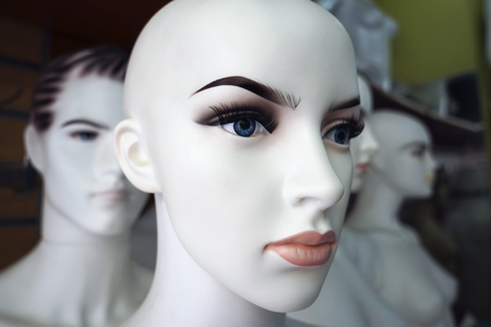 Plastic female and male mannequins