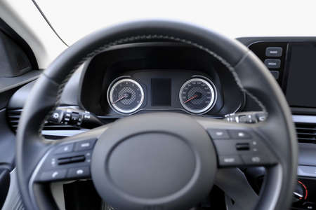Speedometer, rev counter and steering wheel of a car