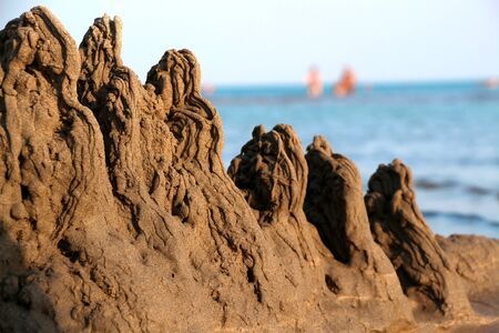 Childrens sand reefs on the shore