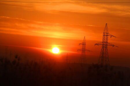 high voltage poles at dawn 写真素材