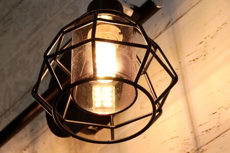 Decorative pleasant modern lamp illuminates Reklamní fotografie